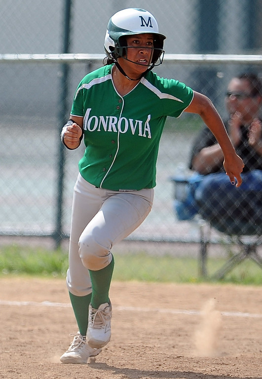 Description of . Monrovia's Galvan Tanya bases loaded double as three runs score in the fifth inning of the Northview Tournament championship softball game against Covina at Northview High School on Thursday, April 4, 2013 in Covina, Calif.  Monrovia won 6-0. 
