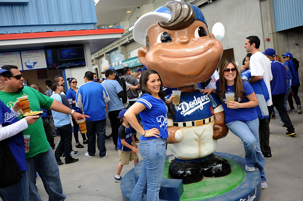 . Fans pose for photos with a large bbblehead doll on opening day at Dodger Stadium April 1, 2013.  The Dodgers hosted the San Francisco Giants.(Andy Holzman/Staff Photographer)