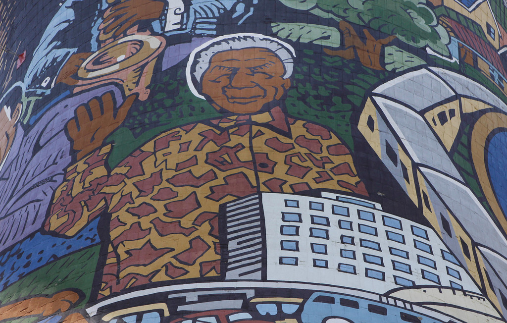 . A giant portrait of former president Nelson Mandela adorns a cooling tower of a now defunct power station in Soweto, South Africa, Monday, Dec 31, 2012. Mandela is recovering at his Johannesburg home since being hopitalized for a lung infection and undergoing gallstone surgery. (AP Photo/Denis Farrell)