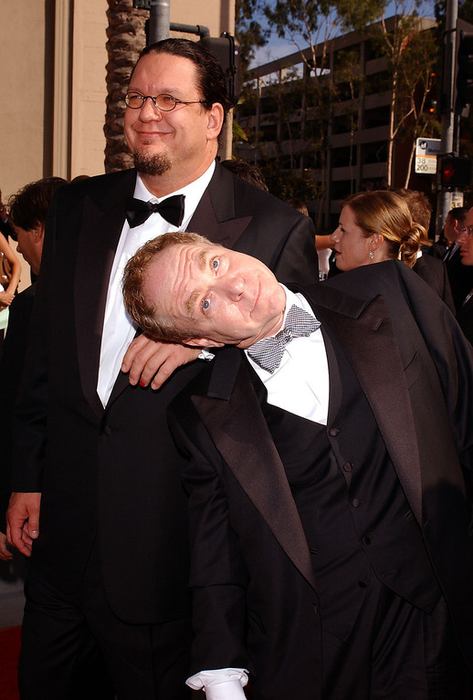 . LOS ANGELES - SEPTEMBER 12:  Magicians Penn and Teller arrive at the 2004 Primetime Creative Arts Emmy Awards on September 12, 2004 at the Shrine Auditorium, in Los Angeles, California. (Photo by Stephen Shugerman/Getty Images)