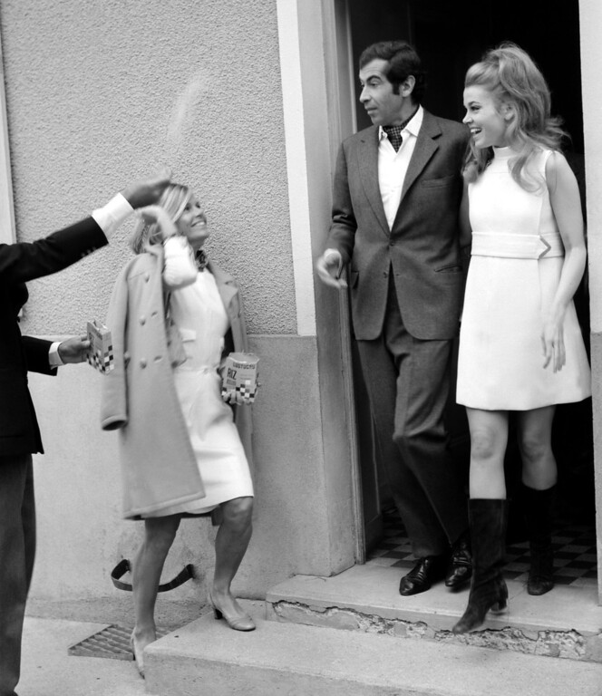 ". SAINT-OUEN MARCHEFROY, FRANCE - MAY 19:  Unidentified friends throw rice at just-wedded French director Roger Vadim and US actress Jane Fonda, 19 Mai 1967 in Saint-Ouen Marchefroy, northwestern France. Roger Vadim Plemiannikov, son of a diplomat, born 26 January 1928 in Paris, director for some 20 films, is mostly remembered for having made actress Brigitte Bardot a star with his feature ""And God created Woman\"" in 1956 and his work and relationships with actresses Catherine Deneuve and Jane Fonda.  (STF/AFP/Getty Images)"