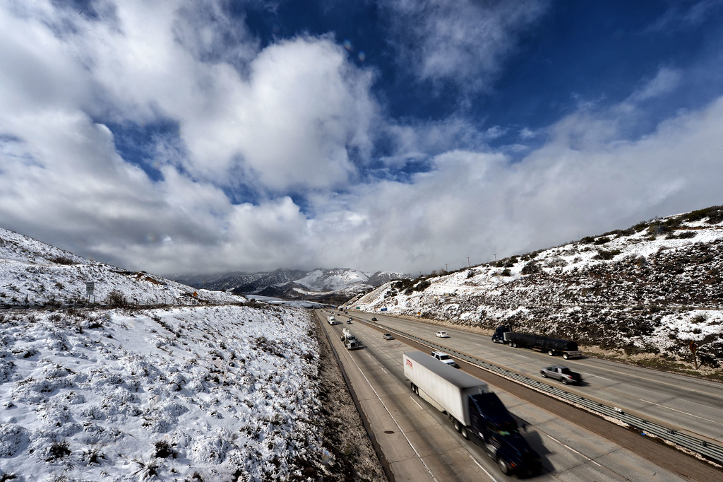 . Snow covers the Tejon Pass as cars make their way along the I-5 freeway north of Los Angeles.  (Hans Gutknecht/Staff Photographer)