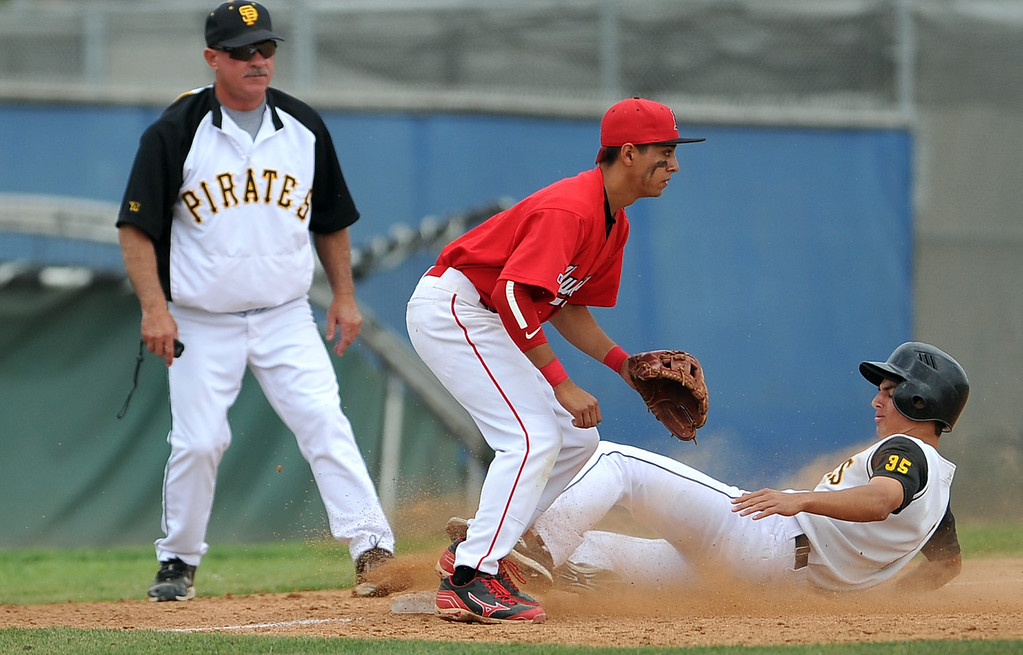 . 4/6/13 - Arron Scognamillo slides into third for San Pedro High School against Arleta High School on Saturday morning at Harbor City College in a non-league game. Photo by Brittany Murray / Staff Photographer