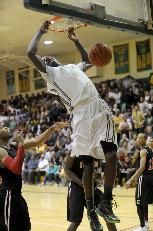 . 02-26-2012--(LANG Staff Photo by Sean Hiller)-Etiwanda beat Long Beach Poly 59-55 in Tuesday\'s CIF Southern Section Division 1AA semifinal boys basketball game at Long Beach Poly High School. Jordan Bell dunks for Poly in overtime.