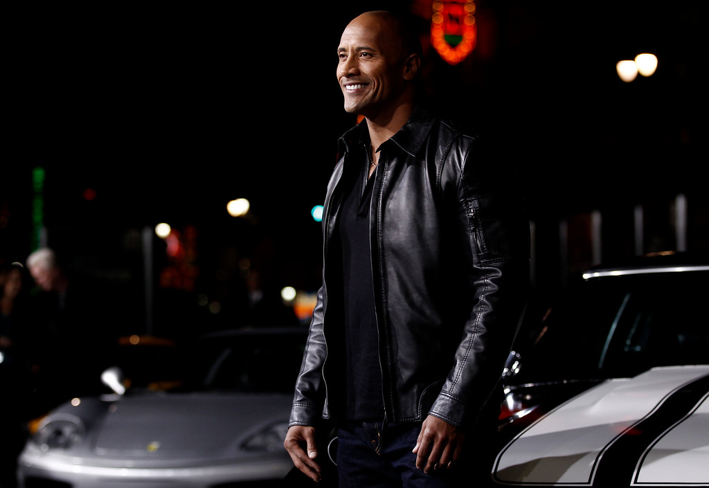 ". Cast member Dwayne Johnson arrives at the premiere of ""Faster\"" in Los Angeles, Monday, Nov. 22, 2010. (AP Photo/Matt Sayles)"