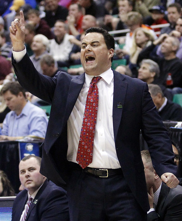 . Arizona head coach Sean Miller shouts to his team in the first half during a second-round game against Belmont in the NCAA college basketball tournament in Salt Lake City, Thursday, March 21, 2013. Arizona won 81-64. (AP Photo/Rick Bowmer)