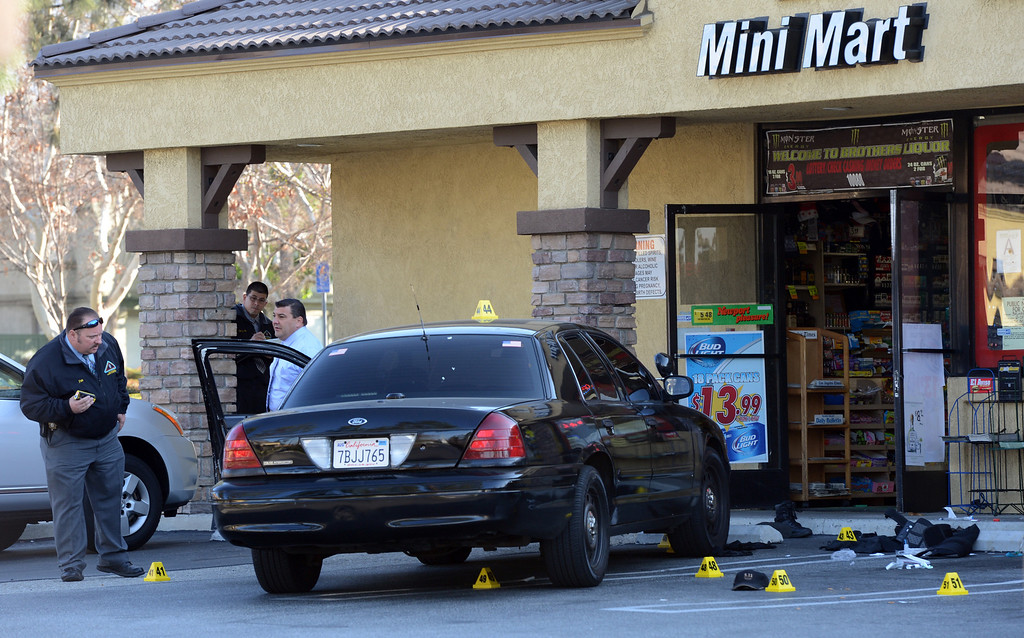 Description of . San Bernardino County sheriff's investigate the scene where a security guard was shot and later died during a robbery at a mini market Saturday night in the 10000 block of Arrow Highway in Rancho Cucamonga, CA., Sunday, February 23, 2014. (Photo by Jennifer Cappuccio Maher/Inland Valley Daily Bulletin)
