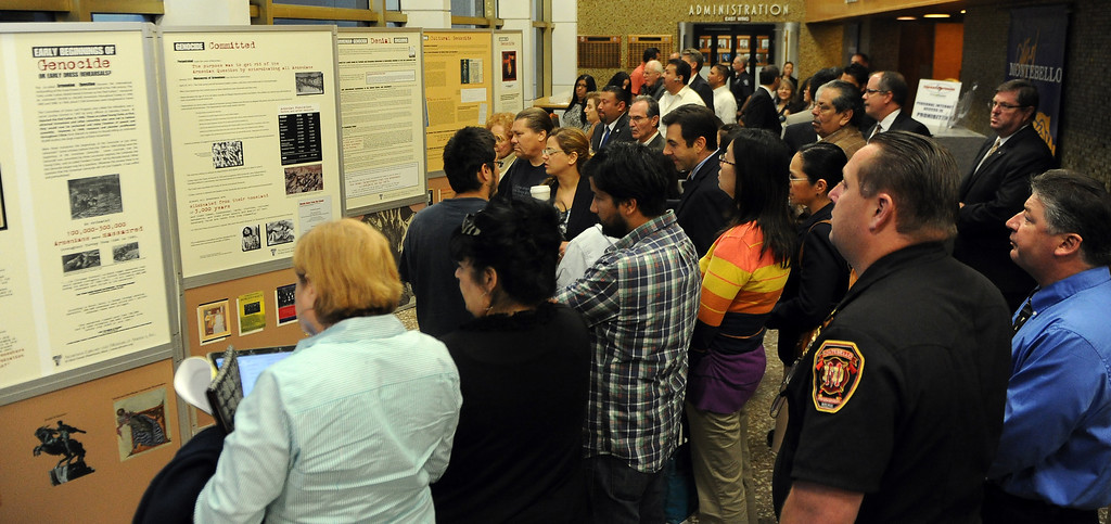 Description of . Locals look over a traveling Armenian Genocide display at the Montebello City Hall on Wednesday, April 10, 2012 in Montebello, Calif. It is the 98th anniversary of the genocide, which occurred between 1915-1923.   (Keith Birmingham/Pasadena Star-News)