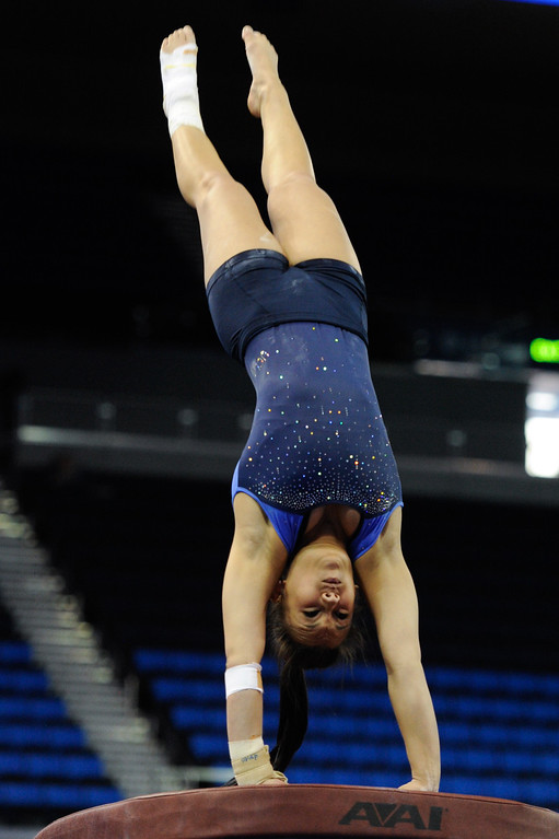 . UCLA\'s Dana McDonald practices on the vault. (Michael Owen Baker/Staff Photographer)