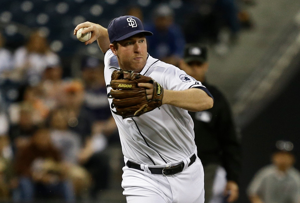 . San Diego Padres third baseman Jedd Gyorko throws out Los Angeles Dodgers\' Matt Kemp during the first inning of a baseball game in San Diego, Wednesday, April 10, 2013. (AP Photo/Lenny Ignelzi)