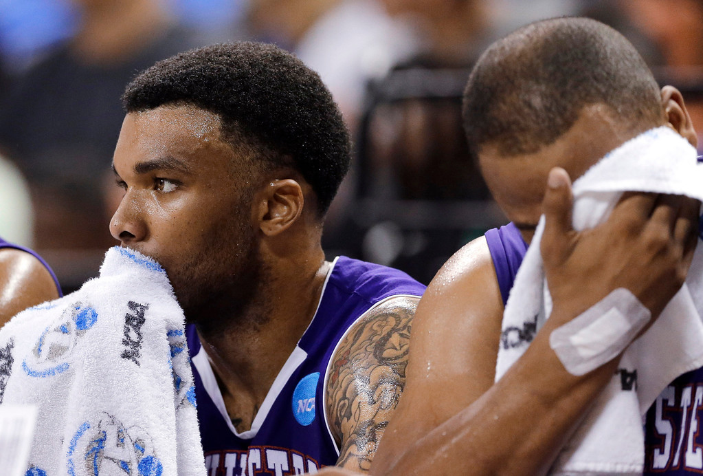. Northwestern State\'s Shamir Davis, left, and DeQuan Hicks, right, sit on the bench during the second half of a second-round game of the NCAA men\'s college basketball tournament against Florida on Friday, March 22, 2013, in Austin, Texas. Florida won 79-47. (AP Photo/David J. Phillip)