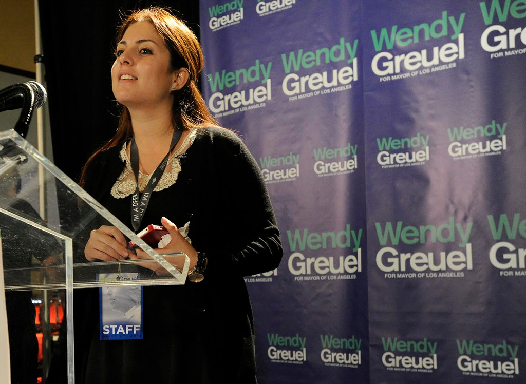 . Connie Llanos, a campaign aid for Greuel, gives the photographers a sample of the lighting from the platform. Wendy Greuel held her election night party at the Los Angeles Brewing Company in downtown Los Angeles, CA 3/5/2013(John McCoy/Staff Photographer)