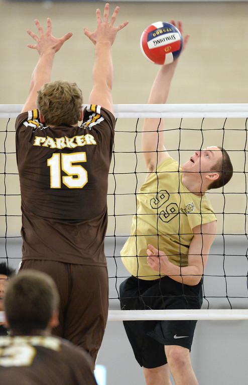 . Bishop Montgomery\'s Matt Kinahan (99) spikes against Parker\'s Bryce Fitzner (15)in a Southern California Regional Division III Final volleyball match Saturday at Santiago Canyon College in Orange. The match came down to the final points of the fifth game, with Bishop Montgomery losing the heart-breaker. Bishop Montgomery vs. Francis Parker (San Diego) 20130525 Photo by Steve McCrank / Staff Photographer