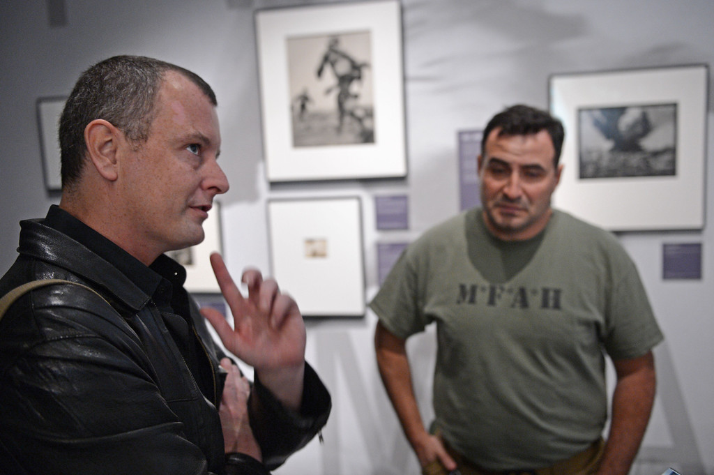 . WAR/Photography - Images of Armed Conflict and its Aftermath. Photography exhibit at the Annenberg Space for Photography. Photographers Ashley Gilbertson, left, and Edouard Gluck reflect on their time spend in war zones with a camera. Photo by Brad Graverson 3-20-13