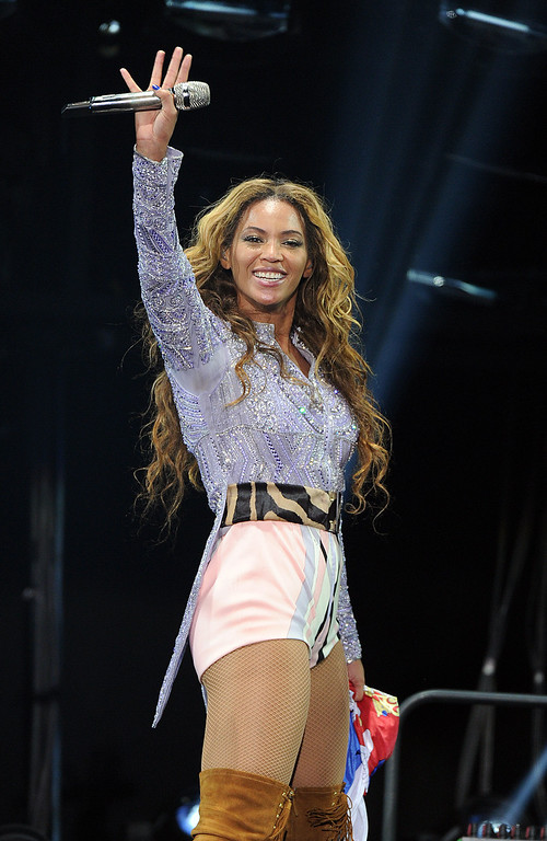 """. Singer Beyonce performs on the opening night of her \""""Mrs. Carter Show World Tour 2013\"""", on Monday, April 15, 2013 at the Kombank Arena in Belgrade, Serbia.  Beyonce is wearing a lilac hand beaded jacket and boots by Pucci. (Photo by Frank Micelotta/Invision for Parkwood Entertainment/AP Images)"""
