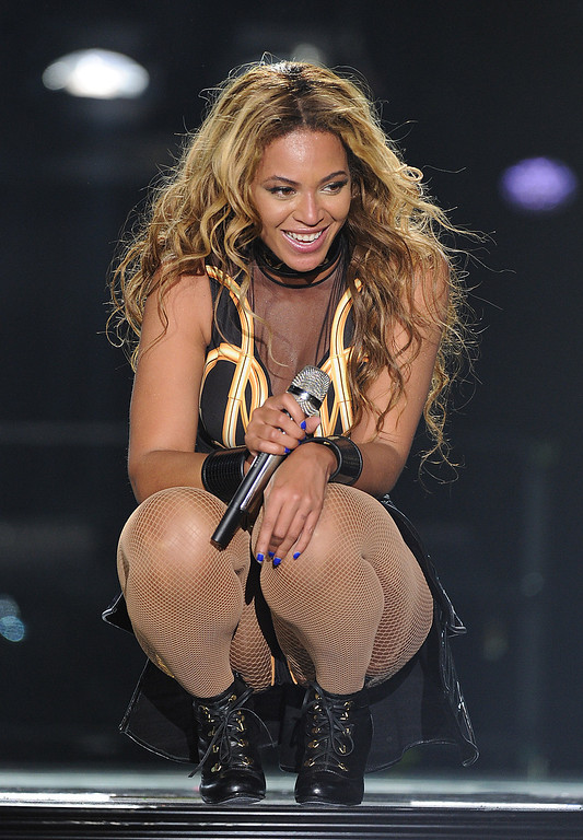 """. Singer Beyonce performs on the opening night of her \""""Mrs. Carter Show World Tour 2013\"""", on Monday, April 15, 2013 at the Kombank Arena in Belgrade, Serbia. Beyonce is wearing a gold and black one-piece with skirt by designer David Koma. (Photo by Frank Micelotta/Invision for Parkwood Entertainment/AP Images)"""