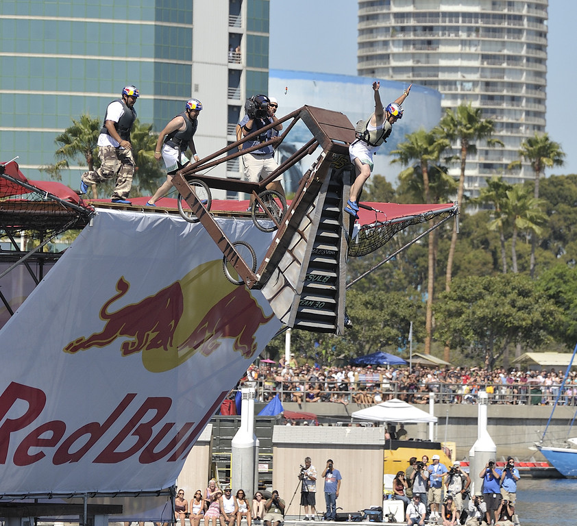 ". LONG BEACH, CALIF. USA -- Jaret Padilla pilots whats left of their Flugtag  ""Flies Like a Butterfly, but Stings Like a Ray\"" after it failed to roll down the ramp in Rainbow Harbor in Long Beach, Calif. on August 21, 2010. Thirty five teams competed in the Red Bull event where teams build homemade, human-powered flying machines and pilot them off a 30-foot high deck in hopes of achieving flight.  Flugtag means \""flying day\"" in German. They are on distance, creativity and showmanship..Photo by Jeff Gritchen / Long Beach Press-Telegram.."