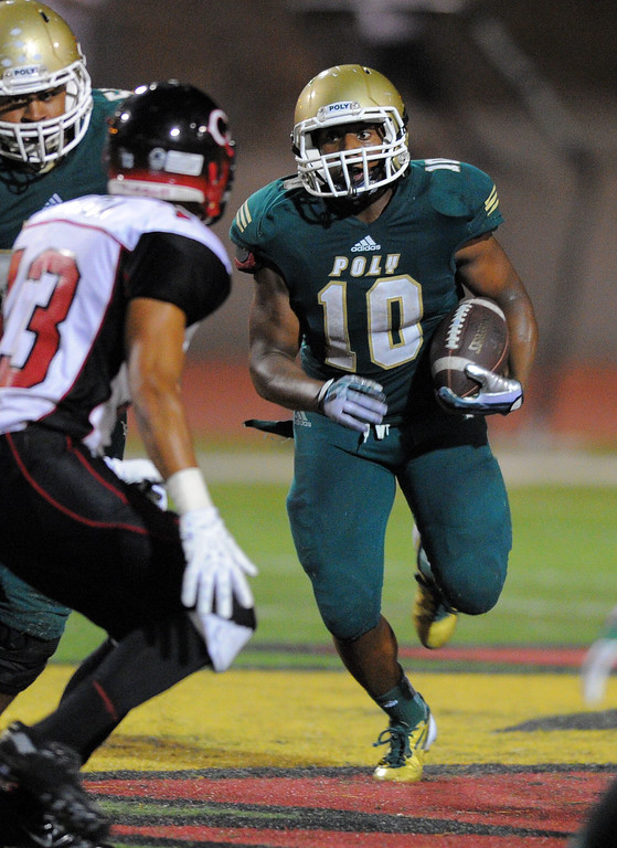 . Long Beach Poly football takes on Centennial (Corona) as part of the Mission Viejo Classic in Mission Viejo, CA on Friday, September 13, 2013. Long Beach Poly won 35-28.  Poly\'s James Brooks. (Photo by Scott Varley, Press-Telegram)