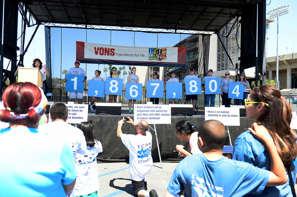 Description of . The amount of money raised during the 11th annual Los Angeles Walk Now for Autism Speaks at the Rose Bowl in Pasadena Saturday April 20, 2013 is shown on the stage. (SGVN/Staff Photo by Sarah Reingewirtz)
