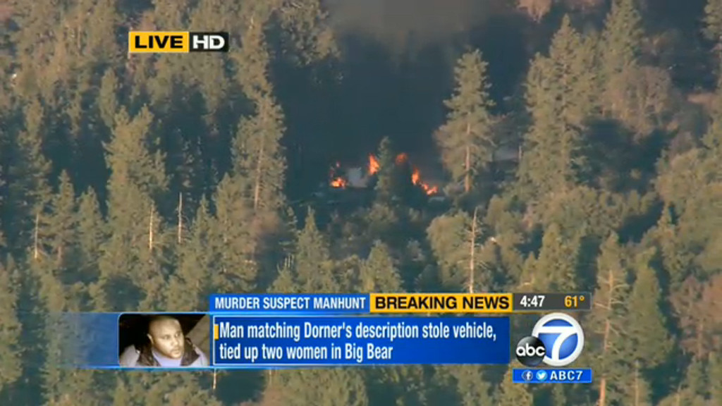 Description of . In this image taken from video provided by KABC-TV, the cabin in Big Bear, Calif. where ex-Los Angeles police officer Christopher Dorner is believed to be barricaded inside is in flames Tuesday, Feb. 12, 2013. (AP Photo/KABC-TV) MANDATORY CREDIT: KABC-TV