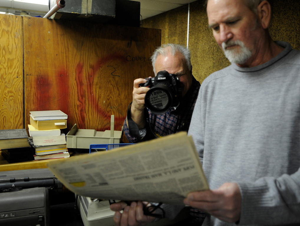 . Leo Jarzomb takes a photo of an old newspaper that Rob Brown found in the old darkroom in the Herald building. Former photographers from the Los Angeles Herald Examiner gathered to take a tour of the old Herald Building, and then join for a panel discussion about their work and their days working at the old Herex. Los Angeles, CA 3/9/2013(John McCoy/Staff Photographer)