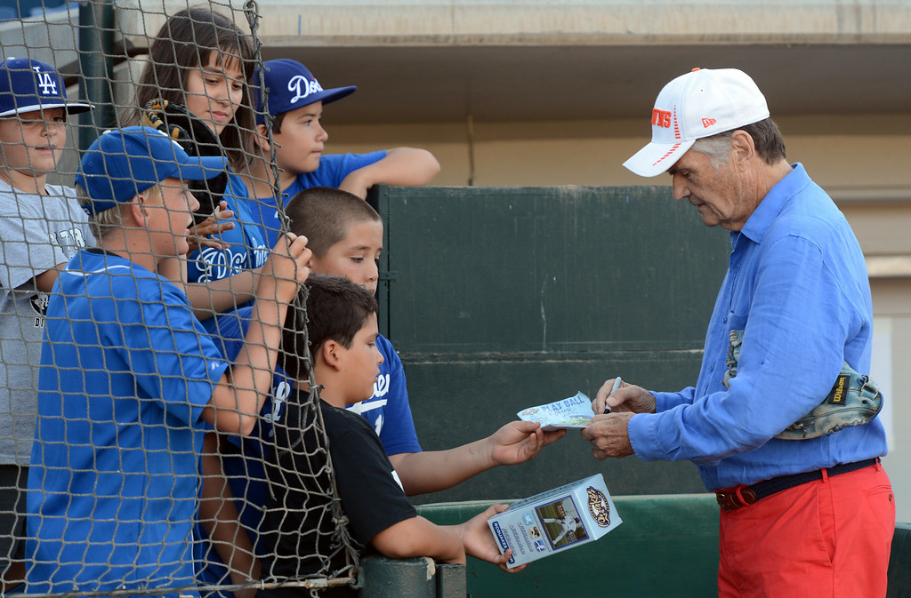 Description of . Actor Fred Willard signs autographs before throwing out the first pitch at the Quakes game at LoanMart Field in Rancho Cucamonga, CA, Friday, August 15, 2014. (Photo by Jennifer Cappuccio Maher/Inland Valley Daily Bulletin)