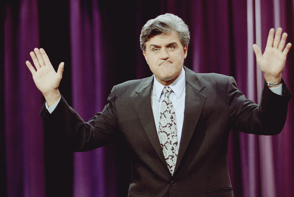 ". Jay Leno gestures during the opening monologue at the inauguration of ""The Tonight Show with Jay Leno\"" which was broadcast live on the east coast from NBC Studios in Burbank, Calif., May 25, 1992. The show features a new band with jazz musician Branford Marsalis as musical director. Leno\'s first guests were comedian Billy Crystal and singer Shanice. (AP Photo/Craig Fujii)"