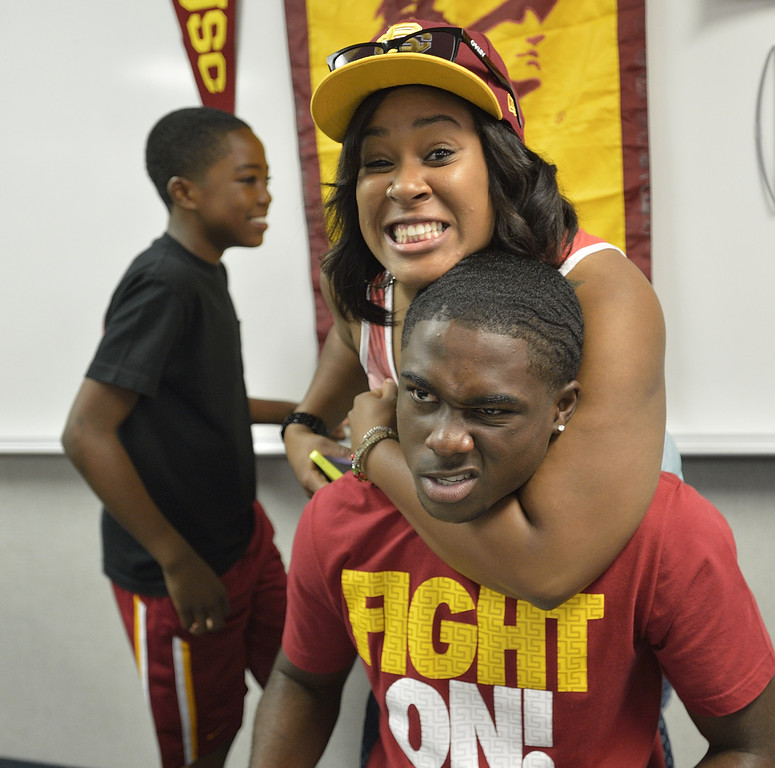 . LAKEWOOD, CALIF. USA -- Destinee Minor jokes with her little brother, Mayfair High recent graduate Aaron Minor, during his Signing Ceremony in Lakewood, Calif., on July 2, 2013. Minor is a late signee with USC football. Photo by Jeff Gritchen / Los Angeles Newspaper Group