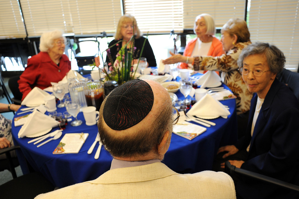 . Participants chat prior to the start of a traditional Passover Seder at the Los Angeles Jewish Home in Reseda, CA March 20, 2013.  More than a dozen residents of Keiro Senior Healthcare in Boyle Heights joined residents of the Los Angeles Jewish Home for the religious celebration Wednesday.(Andy Holzman/Los Angeles Daily News)