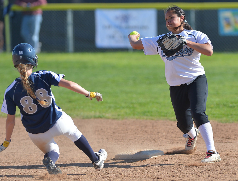 . 0314_SPT_TDB_L_CAR-NORTH--- Torrance, CALIFORNIA--3/13/13--- Staff Photo: Robert Casillas / LANG--- Carson at North Torrance softball. Carson\'s Brianna Tautalafua turns double play on a sliding Megan Ottino.