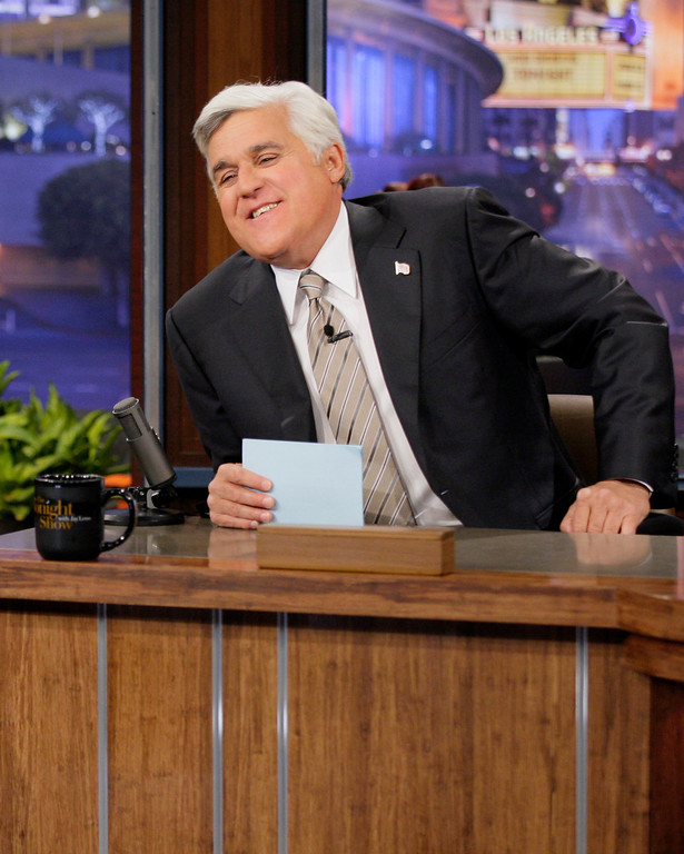 ". This Oct. 24, 2012 photo released by NBC shows Jay Leno, host of ""The Tonight Show with Jay Leno,\"" on the set in Burbank, Calif. NBC announced Wednesday, April 3, 2013 that Jimmy Fallon is replacing Jay Leno as the host of \""The Tonight Show\"" in spring 2014. (AP Photo/NBC, Paul Drinkwater)"