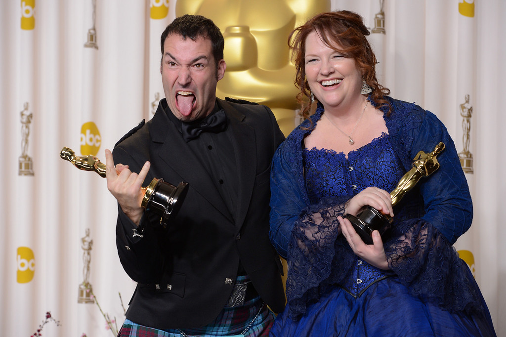 Description of . Mark Andrews and Brenda Chapman accept the award for best animated feature film for