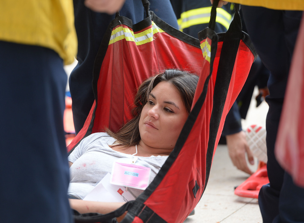 . A multi-agency response exercise to an active shooter and mass casualty incident was held Tuesday on the Cal State Long Beach campus.  Long Beach firefighters evacuate the victims to a triage center. 20130813 Photo by Steve McCrank / Staff Photographer