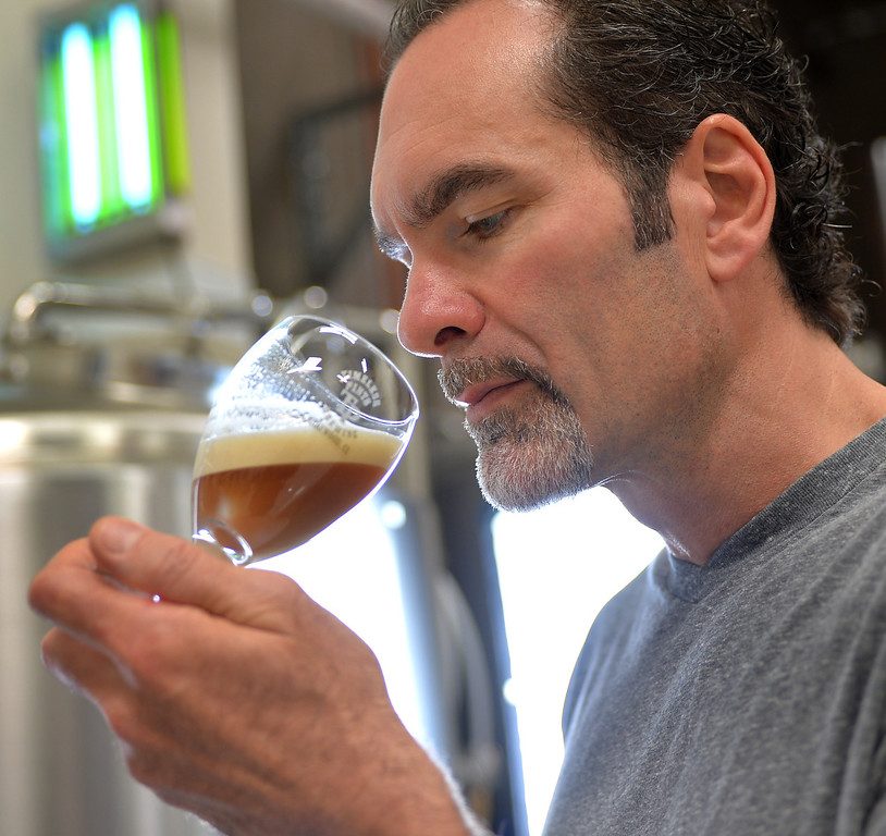 . 0810_NWS_LPT-L-BREWERY--Lakewood, California - Daily Breeze Staff Photo: Robert Casillas / LANG -- Timeless Pints is a new brewery in Lakewood scheduled to open August 16th. Owner Chris Sparacio checks a still fermenting brew.