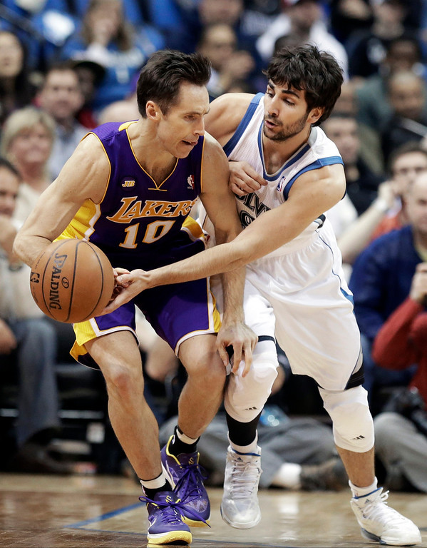 . Minnesota Timberwolves\' Ricky Rubio of Spain, right, pressures Los Angeles Lakers\' Steve Nash in the first quarter of an NBA basketball game Wednesday, March 27, 2013 in Minneapolis. Rubio was called for a foul on the play. (AP Photo/Jim Mone)