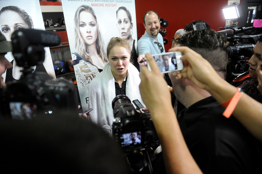 . UFC fighter Ronda Rousey talks to media after an open workout at the UFC Gym in Torrance, CA Wednesday, February 20, 2013. (Hans Gutknecht/Staff Photographer)