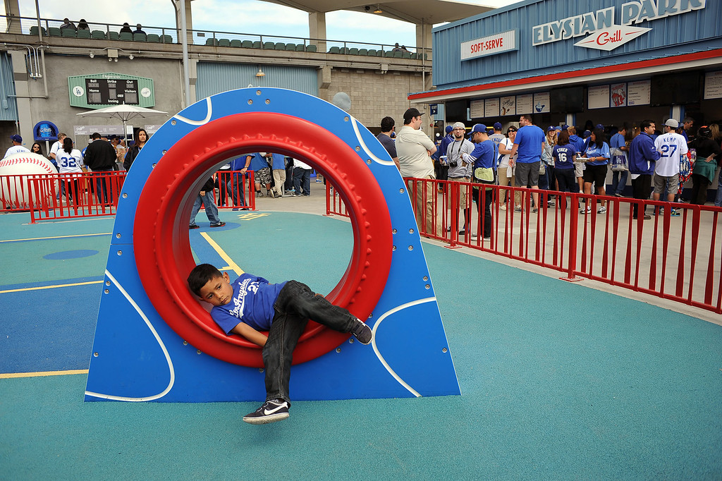 . A youngster plays in a new playground on the reserve level on opening day at Dodger Stadium April 1, 2013.  The Dodgers hosted the San Francisco Giants.(Andy Holzman/Staff Photographer)