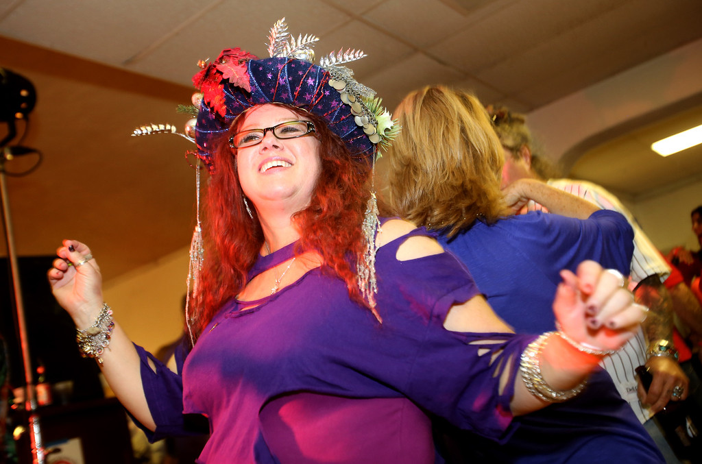 . Former Doo Dah queen, Michelle Mills, also known as Queen Mickie, has fun on the dance floor at the Doo Dah Queen tryouts. The event was held at the American Legion Bar in Pasadena on Sunday, April 7, 2013, and was attended by hopeful contestants, judges, and fans of the parade.  (Photo by Nancy Newman / Pasadena Star-News correspondent )