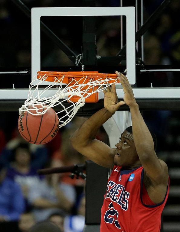 . Mississippi forward Reginald Buckner (23) dunks the ball during the first half of a second-round game against Wisconsin in the NCAA college basketball tournament Friday, March 22, 2013, in Kansas City, Mo. (AP Photo/Charlie Riedel)