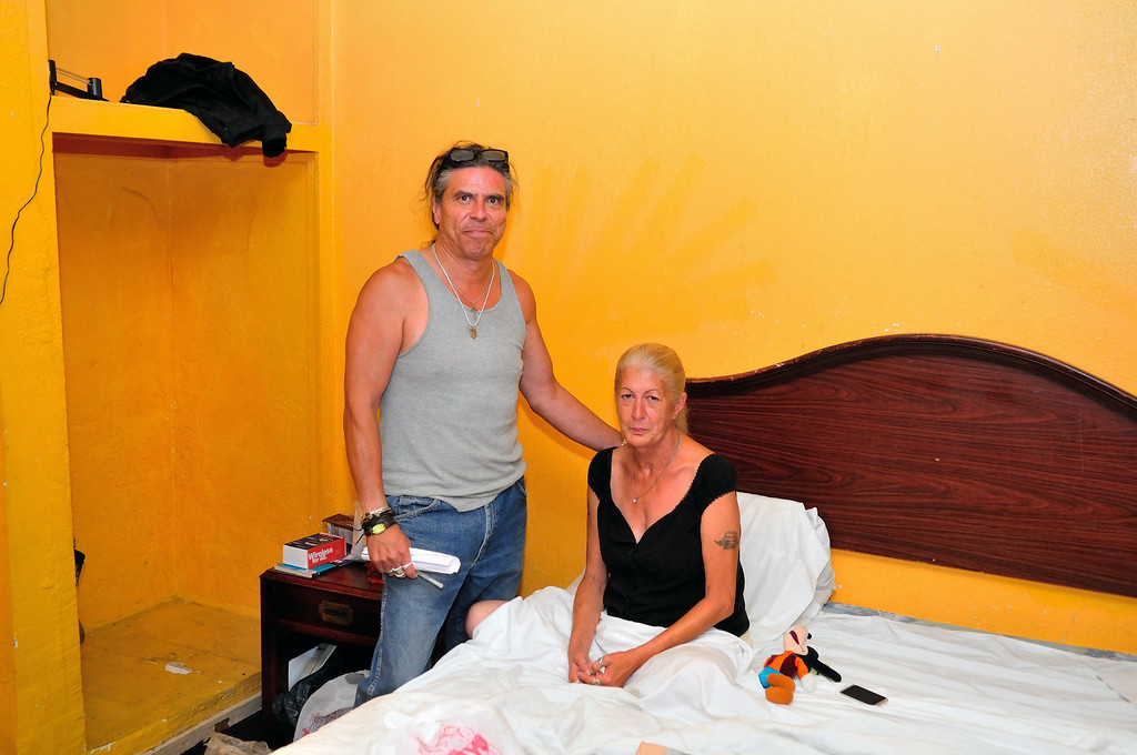 . Alfred Esquivel and his girlfriend in her room at the El Capitan Motor Inn.Photo by Thomas Wasper for the Press Telegram