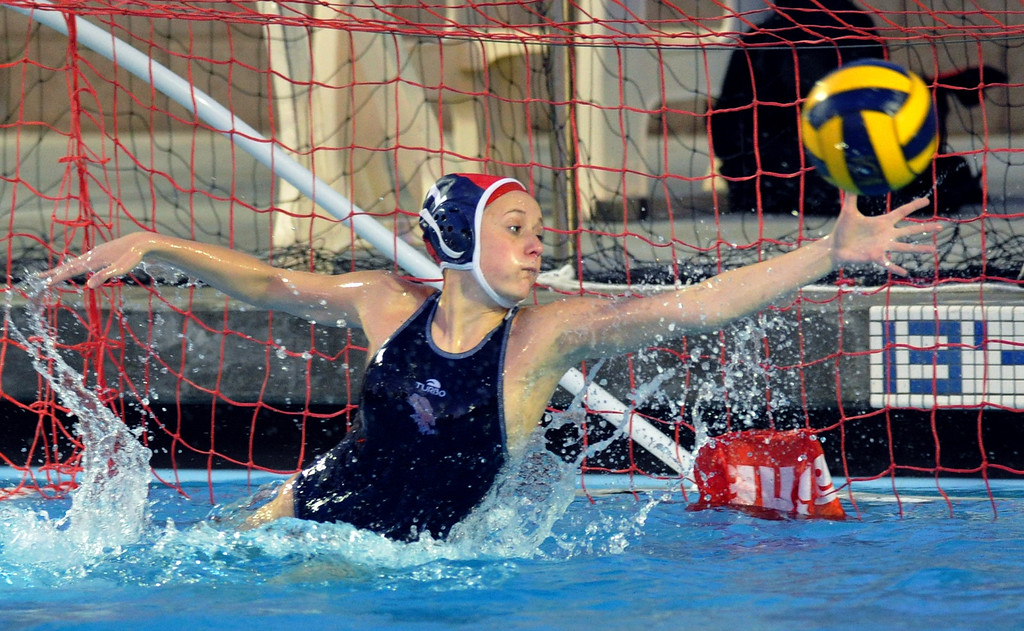 Description of . Crescenta Valley goalie blocks a shot as they play Redlands East Valley in the Southern Section Div. V semifinals girls water polo game at Whittier College's Lillian Slade Aquatics Center on Wednesday February 20, 2013. Crescenta Valley beat Redlands East Valley 14-4. (Staff photo by Keith Durflinger)