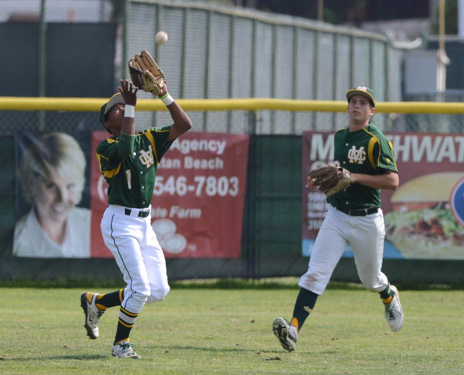 . Mira Costa centerfielder Kenyon Allen makes a catch. Mira Costa defeated Westchester 2-1 at home in boy\'s baseball.  Photo by Brad Graverson 3-26-13
