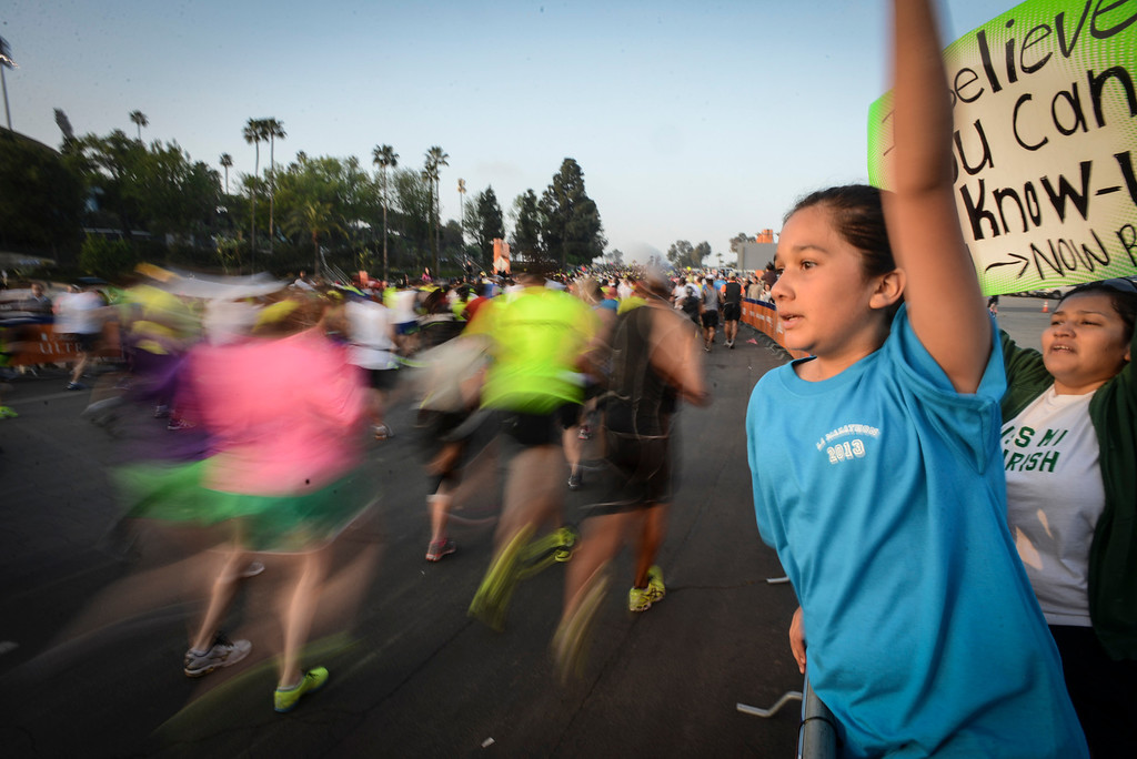 . Daniel Stieiger, 11, of Lake Hughes cheers on family members at the start of the LA Marathon Sunday at Dodger Stadium. Photo by David Crane/Staff Photographer