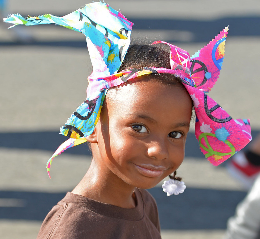 . The 26th Annual Martin Luther King, Jr., Peace & Unity Parade Saturday, January 18, 2014, Long Beach, CA.   A young member of The Rescue, an animal rescue organization, flashes a smile. Photo by Steve McCrank/Daily Breeze