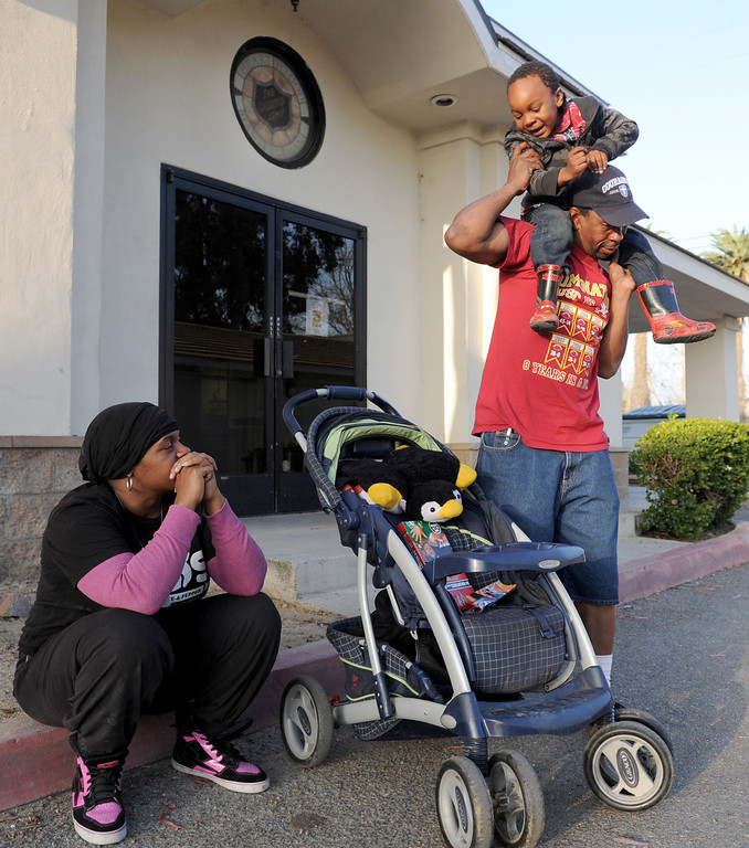 . (John Valenzuela/Staff Photographer)  Danielle Parks and Curtis Wagner of Redlands, along with son Curtis Jr.,4, have struggle to make ends meet after getting evicted from their home in San Bernardino in December. Parks and Wagner have received help from family and handouts from the community, along with panhandling to earn money for their motel room they\'ve been staying in for the past three weeks.