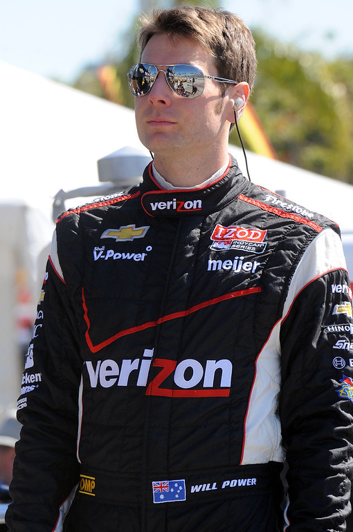 . (Will Lester/Staff Photographer)  Indycar driver Will Power walks the pits Friday morning April 19, 2013 at the 39th annual Toyota Grand Prix of Long Beach.