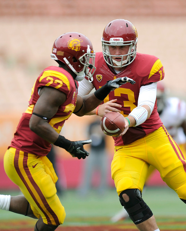 . QB Max Wittek hands off to RB Justin Davis during USC\'s Spring Football Game at the L.A. Memorial Coliseum, Saturday, April 13, 2013. (Michael Owen Baker/Staff Photographer)