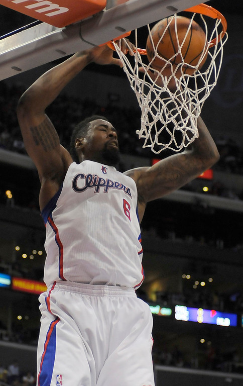 . Clippers#6 DeAndre Jordan dunks the ball in the first half. The Clippers played the Minnesota Timberwolves in a game played at Staples Center in Los Angeles, CA 4/10/2013(John McCoy/Staff Photographer