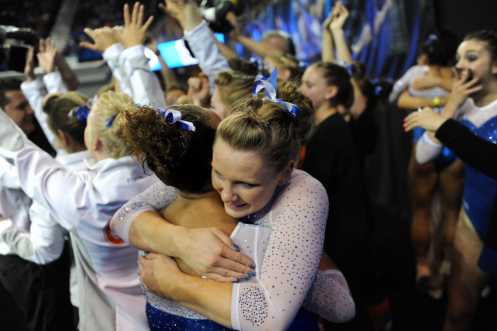 . Florida\'s Bridget Sloan, facing camera, and Kytra Hunter hug after hearing they won the NCAA Women\'s Gymnastics Championship Team Finals at Pauley Pavilion, Saturday, April 20, 2013. (Michael Owen Baker/Staff Photographer)