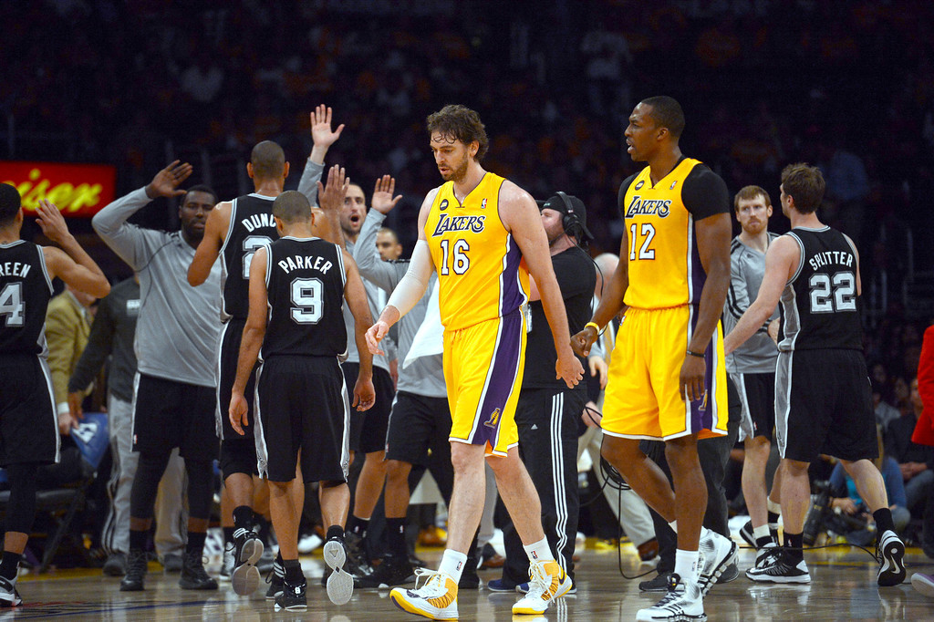 . The Lakers\'  Pau Gasol #16 and Dwight Howard #12 walk off the court in the 3rd period during game three of their NBA Western Conference playoffs against the Spurs at the Staples Center Friday, April 26, 2013. The Spurs beat the Lakers 120-89. (Hans Gutknecht/Staff Photographer)r)